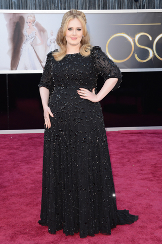 Adele, in Jenny Packham, with jewels by Harry Winston and Lorraine Schwartz.