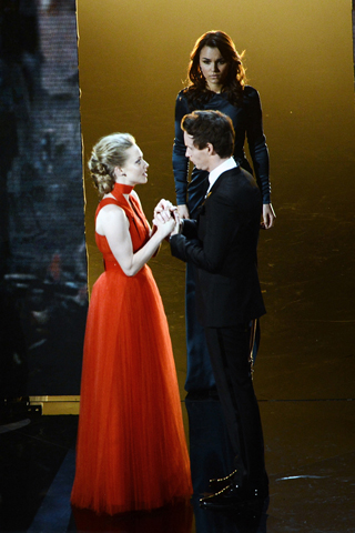Amanda Seyfried, in Givenchy Haute Couture, and Eddie Redmayne, in Burberry Prorsum.